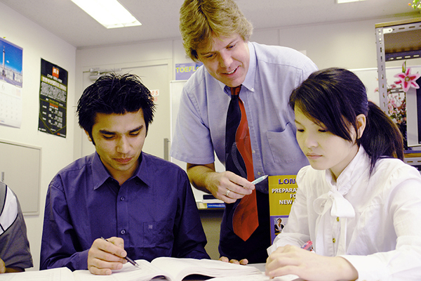 Thom Burns, center, an Old Orchard Beach resident who is currently working as an English teacher at Tokyo English Specialists College in Tokyo, is pictured at the school with students K.C. Rabindra, left, and Chin Shin.