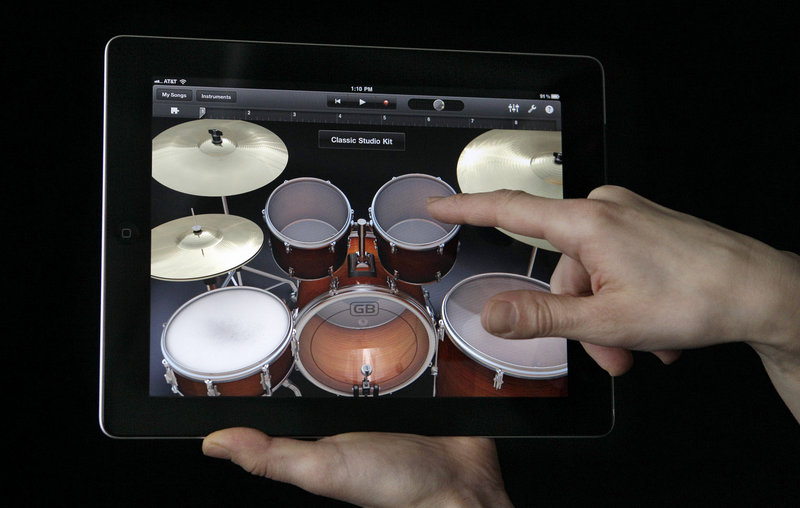 The new Apple iPad 2 is thinner and lighter than the iPad, comes with the Garage Band application, seen above, and the same base price as it did about a year ago – $499.