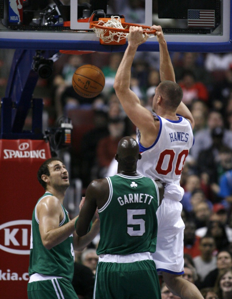 Spencer Hawes of the 76ers dunks between Nenad Krstic, left, and Kevin Garnett of the Celtics on Friday. Hawes had 14 points and 10 rebounds in Philadelphia's 89-86 victory.
