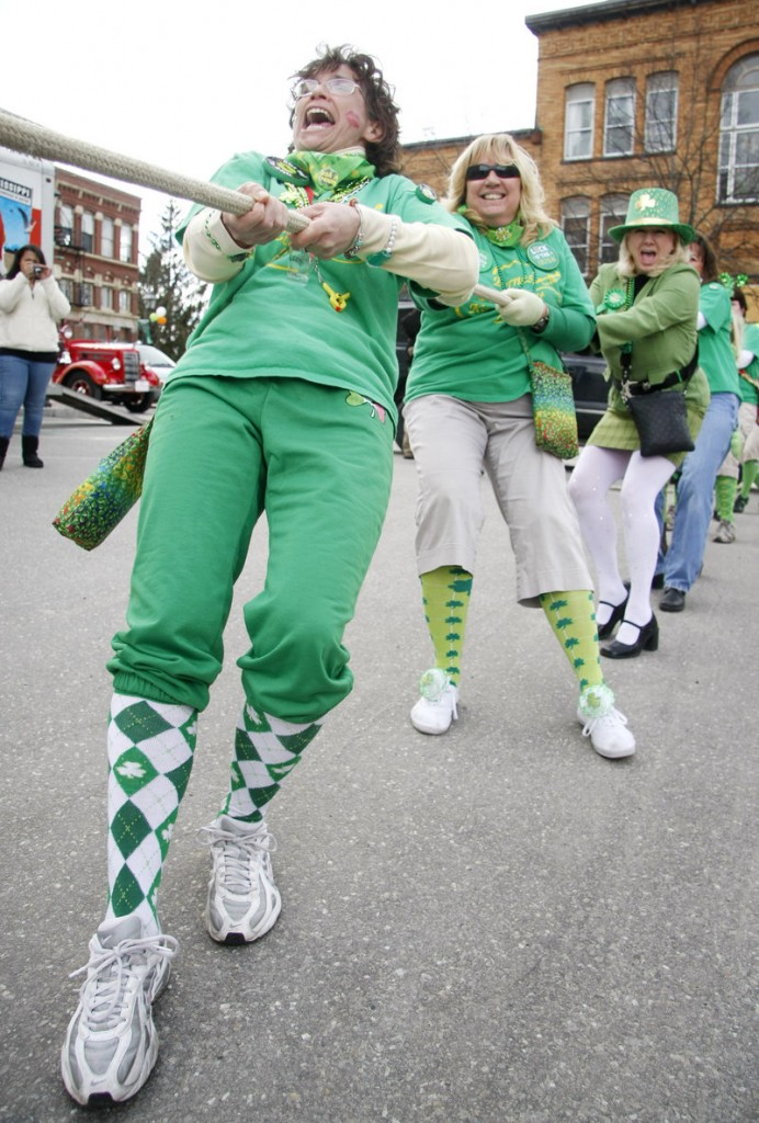 From left, Rose Wood, Lynn Roberts and Sharon Sciretta, all of the Byrnes Irish Pub Pub Scouts Band, brace themselves Saturday while participating in the Bath Blarney Days annual Tug of War following the parade.