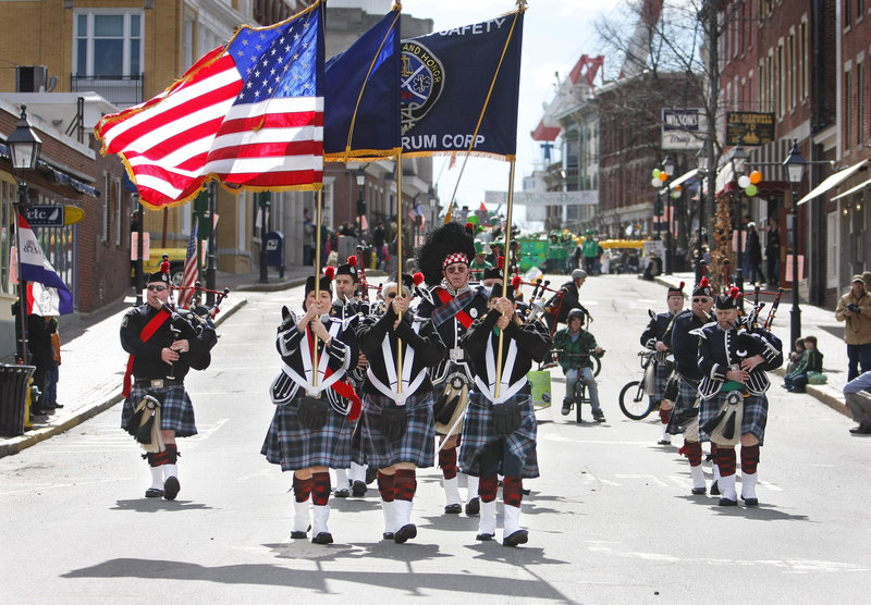 The Maine Public Safety Pipe and Drum Corps fills Front Street with music during the Bath Blarney Days parade Saturday.