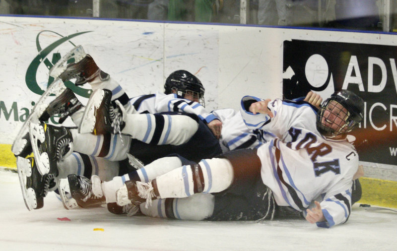 York's Anthony Figlioli, right, looks up from a pile after he scored the winning goal in overtime during the state Class B final against Brewer.