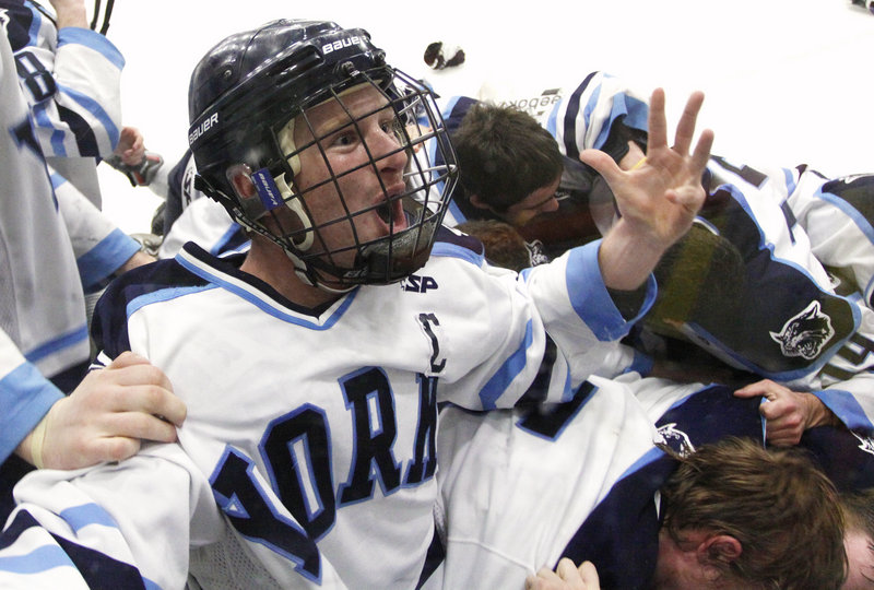 Anthony Figlioli of York had a lot to celebrate Saturday. After all, how many times does a player get to score the overtime goal that gives his team the Class B state championship? Figlioli did it in a 4-3 victory against previously undefeated Brewer in Lewiston.
