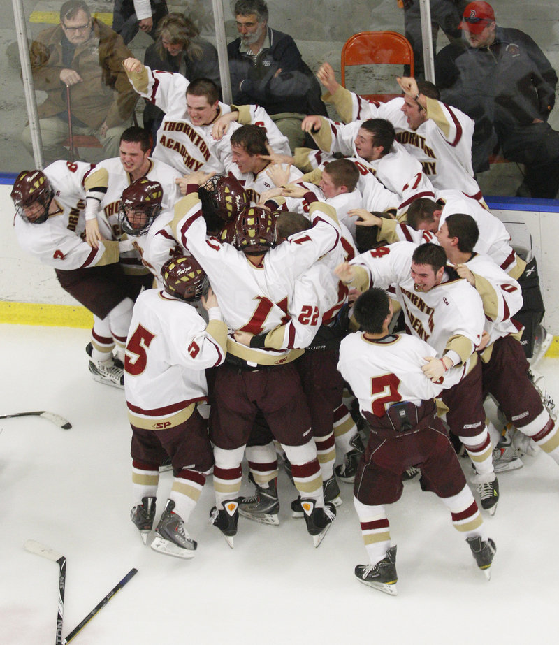The first state hockey title in school history won, the Thornton Academy players had their never-to-be-forgotten moment Saturday night after beating Lewiston in two OTs.