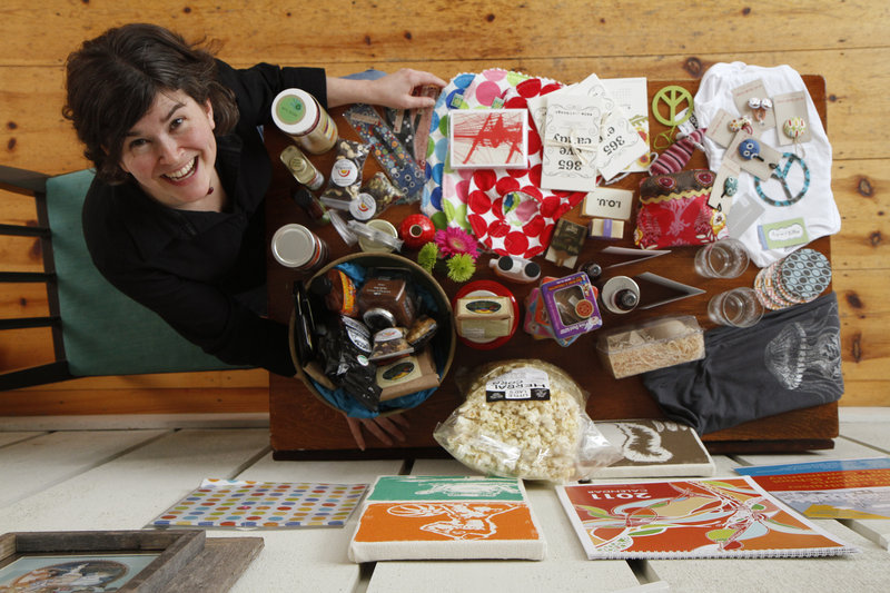 Masey Kaplan shows products from her school fundraising catalog, Close Buy, at her Falmouth home. The catalog features products made by local companies, such as lip balms from Westbrook-based Mad Gab's and handbags from Angela Adams.
