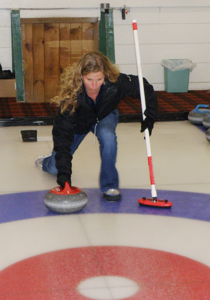 Shannon Bryan masters the art of not falling down while learning to curl with the Belfast Curling Club.