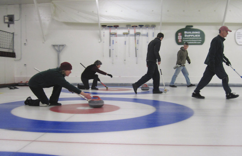 Teams play on side-by-side sheets at the home of the Belfast Curling Club, Maine's only curling clubhouse.
