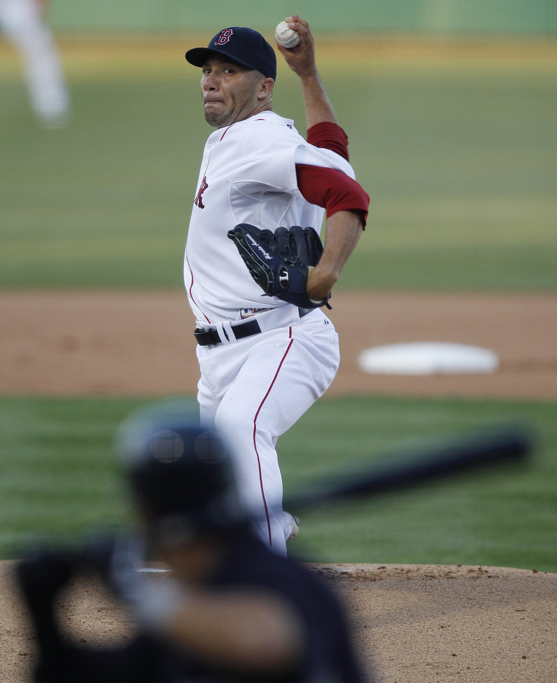Alfredo Aceves, now with the Red Sox after pitching for the Yankees, was the starter in Boston's 2-1 victory.