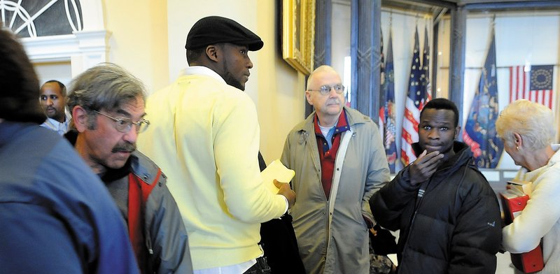 Mainers wait outside a committee room in the State House to testify on the budget earlier this month.