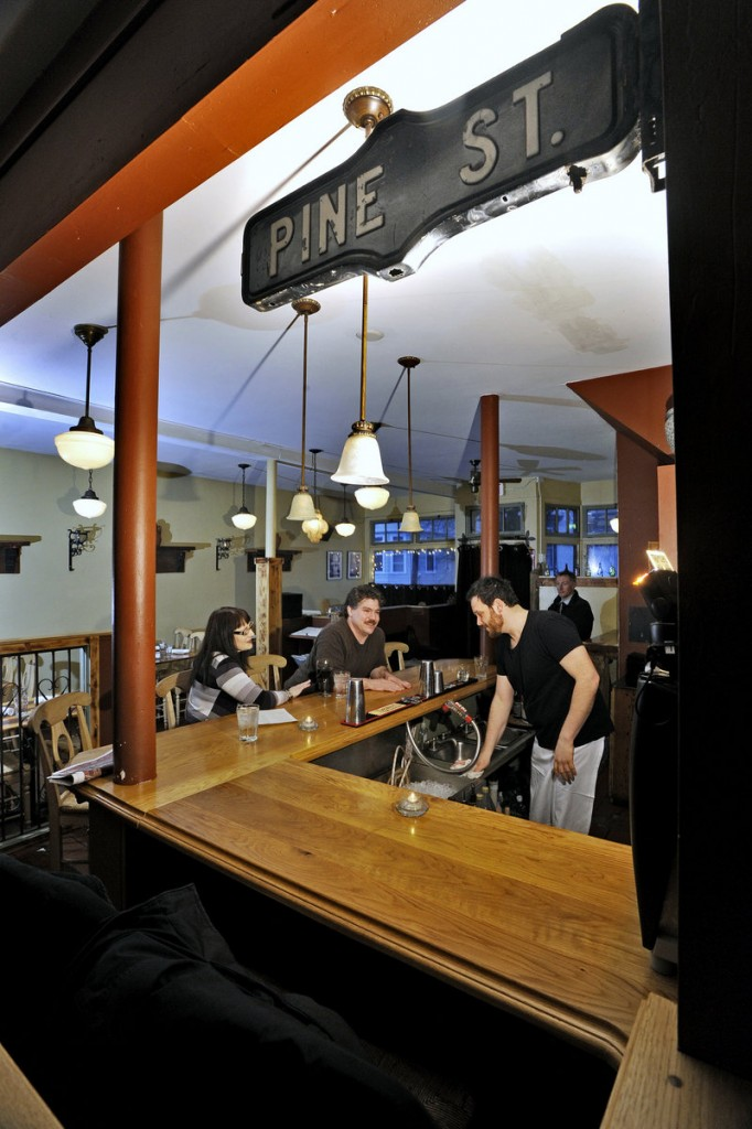 Caiola's has a relaxed atmosphere with rustic wood furnishings, earthy colors and mismatched ceiling fixtures.