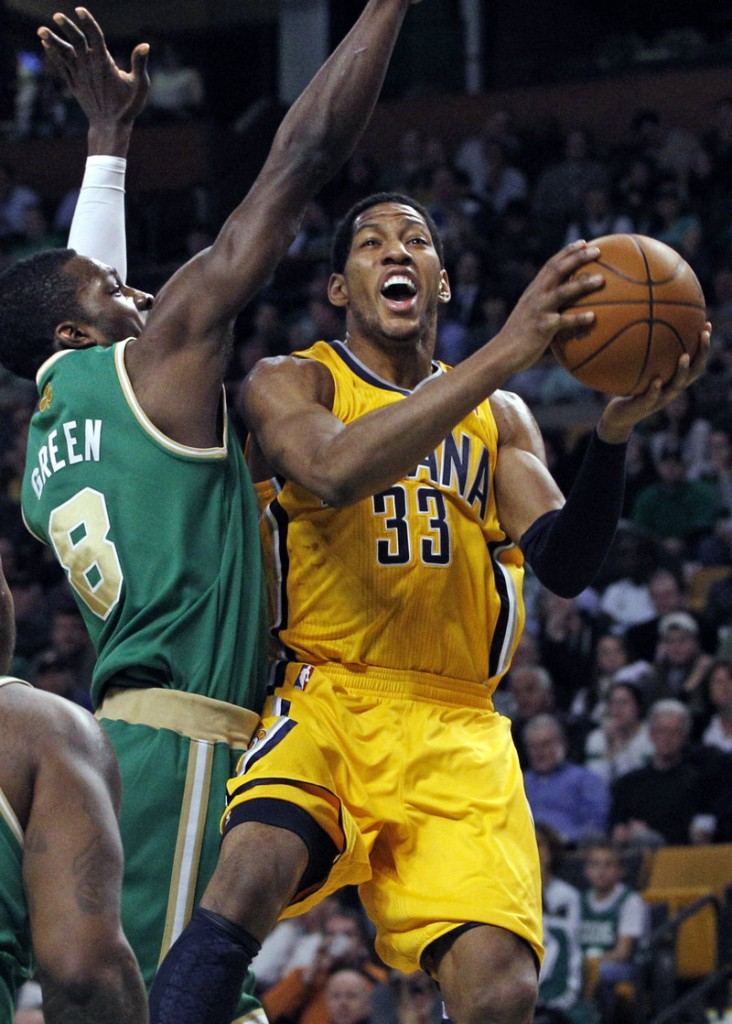 Danny Granger of the Indiana Pacers tries to find a way around Jeff Green, who scored 19 points off the bench Wednesday night for the Boston Celtics in a 92-80 victory.