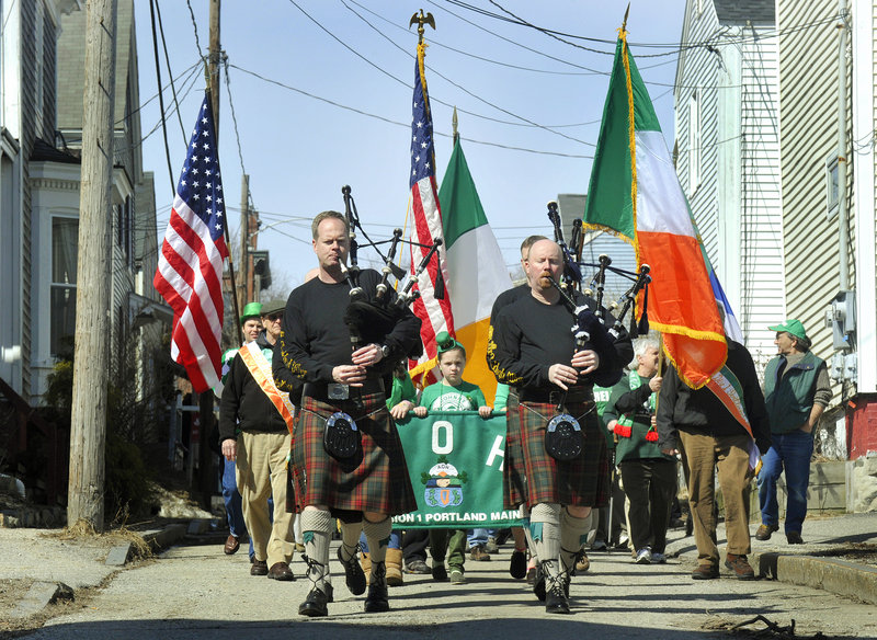 Portland celebrated St. Patrick's Day as the Claddagh Mhor Pipe Band led a parade from the Maine Irish Heritage Center to Harbor View Memorial Park, where members of the Ancient Order of Hibernians and the Irish American Club of Maine raised the U.S. and Irish flags.