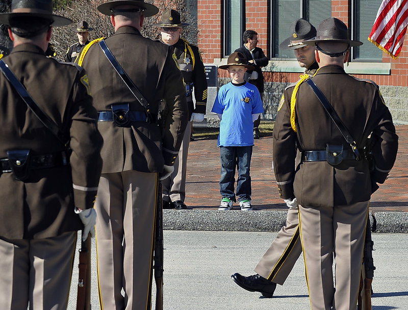 Cameron stands at attention during the military inspection Thursday, held as part of his Make-a-Wish gift.