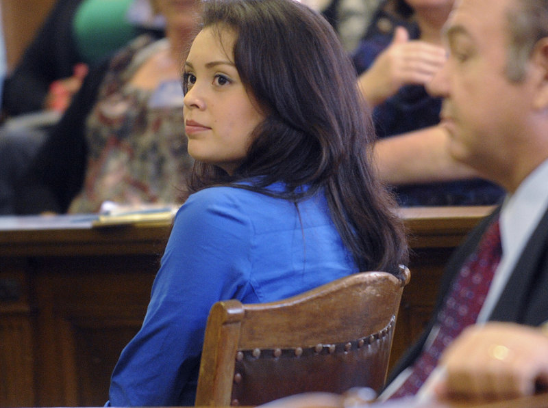"Former Miss San Antonio Domonique Ramirez sits in court during opening arguments in her lawsuit against the Miss San Antonio pageant. Ramirez was allegedly told to ""get off the tacos"" before being stripped of her crown in January."