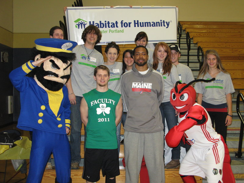 A group of students from Providence College in Rhode Island spent some time in Greater Portland working for Habitat for Humanity as part of an alternative spring break. In the front row are, from left, Yachty, the Falmouth High School mascot; Trevor Paul, a faculty member and event founder; Antonio Anderson, a player for the Maine Red Claws, and Crusher, Red Claws mascot. The Providence College students are in the second row.