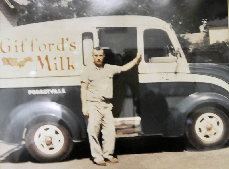 A family photo showing Randall Gifford Jr. circa 1960 with a milk truck in Forestville, Conn., hangs on a wall at Gifford's Ice Cream in Skowhegan. He moved to Maine when he bought Titcomb's Dairy in Farmington on the early 1970s.