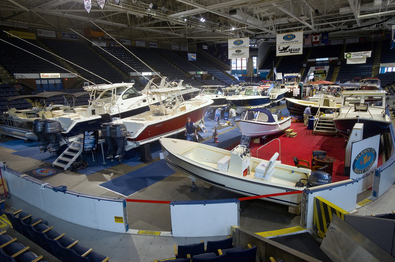 Powerboats in all shapes and sizes – and price ranges – fill the Cumberland County Civic Center on Friday. The 40th Maine Boat Show, held just weeks before the season begins, comes at a key time for sellers.