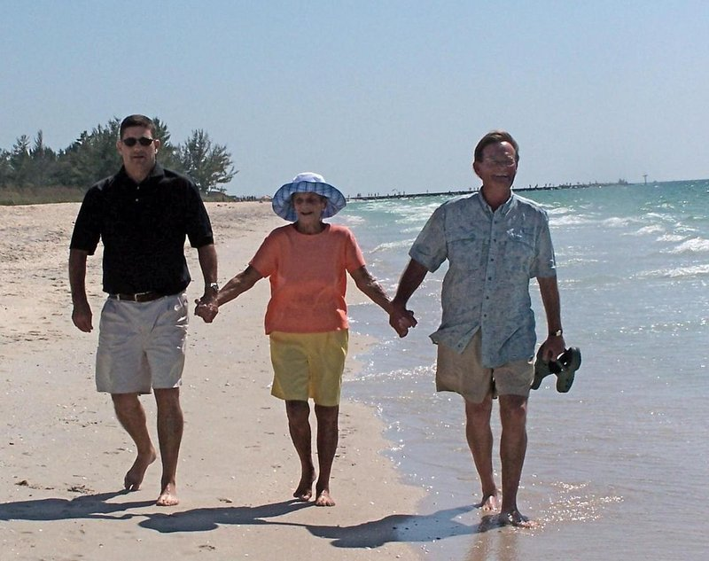 John Noble, III, right, walks the beach in Venice. Fla. in 2009 with his brother Tallison and his mother, Barbara.
