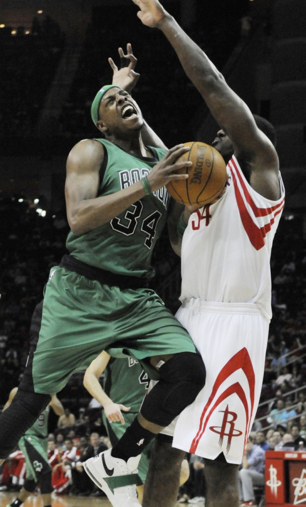 Paul Pierce of the Celtics drives into Patrick Patterson of the Rockets on Friday. Pierce was held to 10 points.