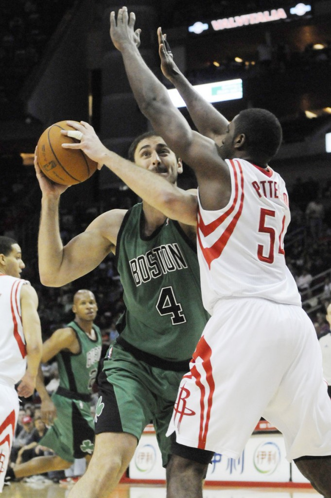 Nenad Krstic of the Boston Celtics looks for a way around Patrick Patterson of Houston. The Celtics lost, 93-77.