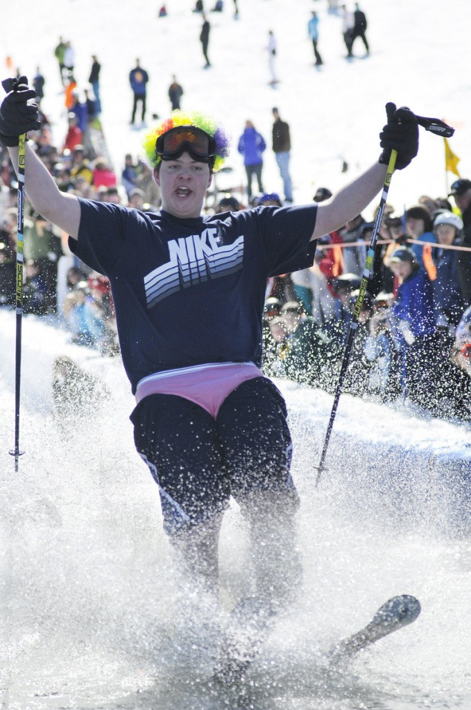 Chris Gagne of Raymond is dressed for a beach party as he competes in the Slush Cup.