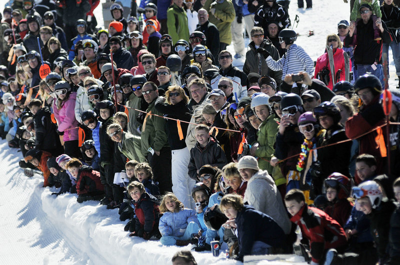 A crowd gathers to watch the Slush Cup at the 26th annual Spring Fling Beach Party at Shawnee Peak.