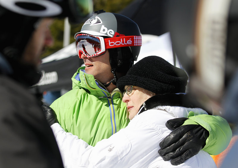 Seth Wescott keeps an eye on the competition Saturday at the Sugarloaf Banked Slalom while spending time with his mother, Margaret Gould Wescott.