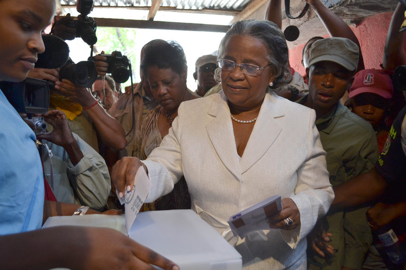 Presidential candidate Mirlande Manigat casts her ballot at a polling station in Port-au-Prince, Haiti, during the presidential runoff election Sunday.