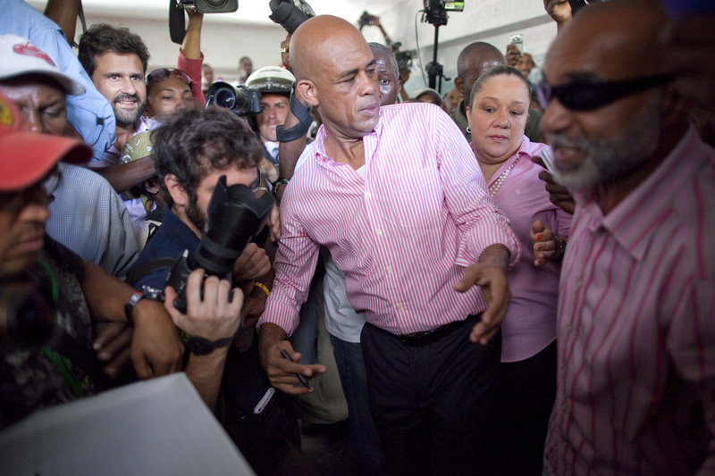 Candidate Michel Martelly gestures before casting his ballot at a polling station during the presidential runoff in Port-au-Prince, Haiti, Sunday.