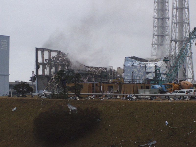 Smoke rises Monday from Unit 3 of the Fukushima Dai-ichi nuclear power plant in Japan. The plant's operator, Tokyo Electric Power Co., temporarily evacuated its workers from the site but did not disclose the cause of the plume. At left is Unit 2 and at right is Unit 4.