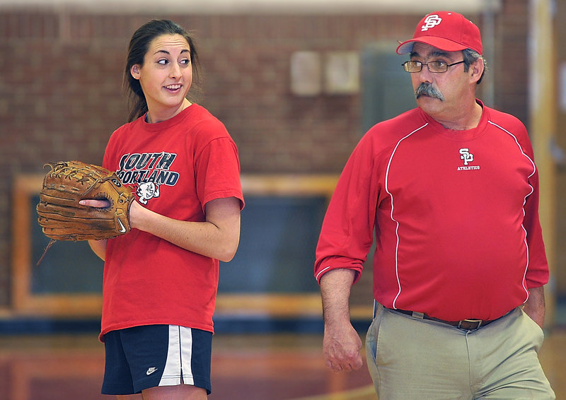 South Portland pitcher Alexis Bogdanovich seems happy to get the preseason under way as Coach Ralph Aceto keeps a watchful eye on proceedings at South Portland High on Monday.