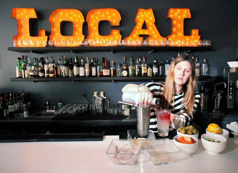 Merrilee Paul, co-owner of 50 Local in Kennebunk, mixes a cocktail. Paul says the food and drink menus are constantly in flux with the changing climate to take advantage of the best local ingredients.