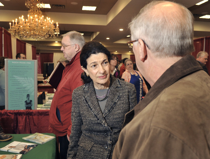 "Maine Sen. Olympia Snowe chats Tuesday with a job fair visitor. She said the number of job seekers there ""underscores the dimension of unemployment problems"" in the state."