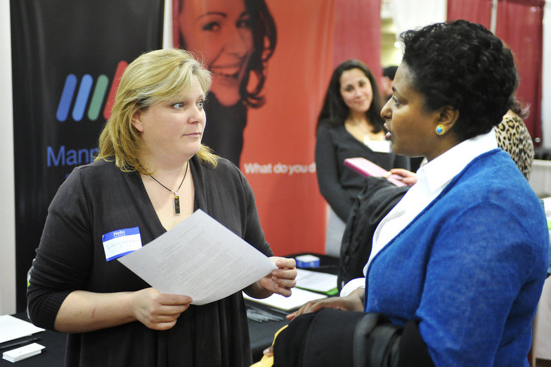 Manpower representative Mary Leighton, left, accepts a resume from Tegest Herrmann during the Maine Sunday Telegram/Monster Career Fair held Tuesday at the Italian Heritage Center in Portland. Forty-five companies participated in the fair.