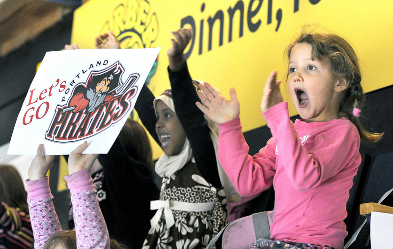Reiche Community School kindergartners Nasteeho Mohamud, 5, left, and Greta Holmes, 6, are among more than 3,600 students from more than 20 schools taking time out from classes Tuesday to watch the Portland Pirates play the Worcester Sharks at the Cumberland County Civic Center in Portland.