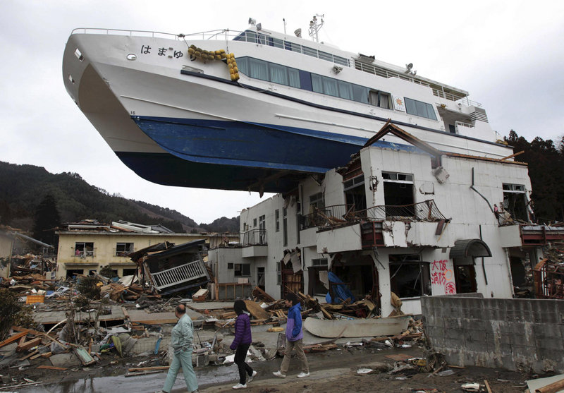 A boat sits atop a building Tuesday in Otsuchi, Japan, after a March 11 earthquake and tsunami that devastated a vast area of the nation's northeastern coast. A nuclear crisis has complicated the government's response to the disaster that killed about 18,000 people.