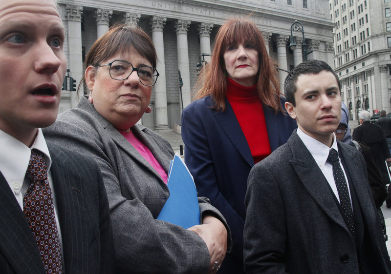 Attorney Noah Lewis, left, speaks during a news conference Tuesday after filing a lawsuit against New York City on behalf of transgender people seeking to change their birth certificates. Next to him from left to right are Joan Marie Prinzivalli, Patricia Harrington and Sam Berkley.