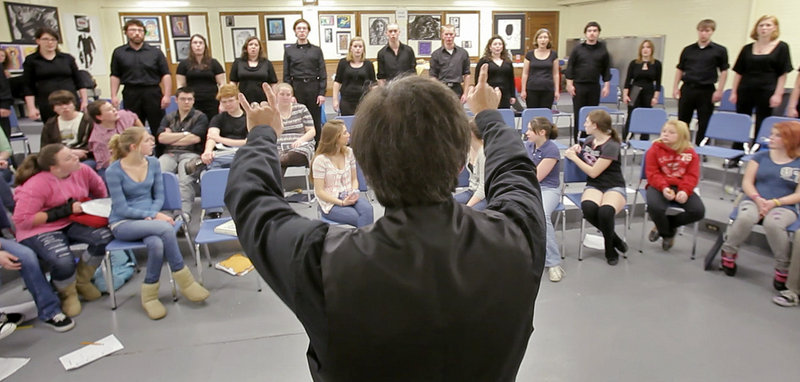 "Professor Robert Russell conducts the USM Chamber Singers at Kennebunk High School on Wednesday, as middle school and high school students listen. ""They used to say that USM is the best-kept secret. We want to counter that,"" he said."