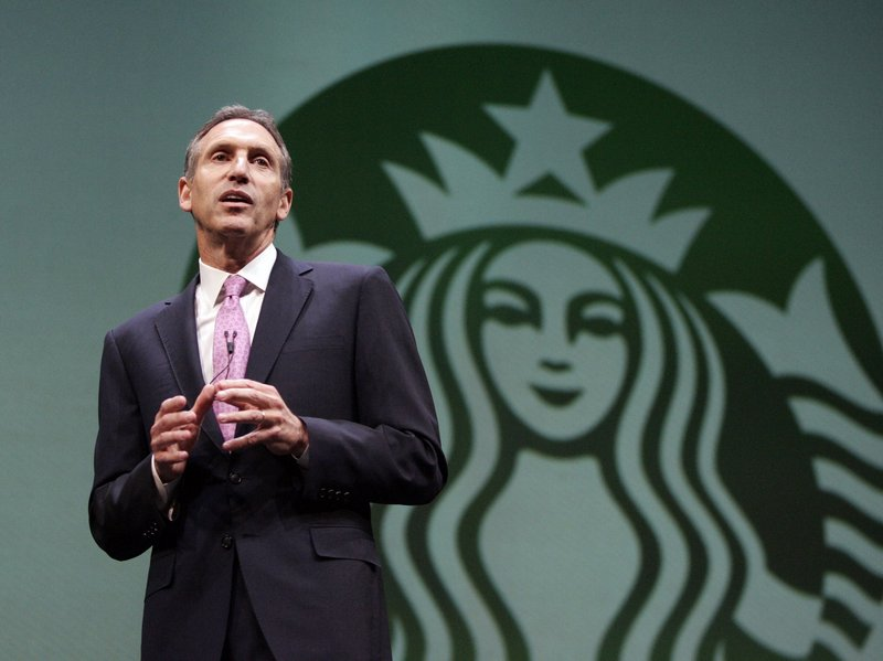 """Starbucks CEO Howard Schultz begins the 2011 shareholders meeting Wednesday in Seattle, Wash. Starbucks Corp. is expanding the products and places it sells to customers and adding extras – like free online access to Marvel Comics in its cafes and single-serve coffee machines in other stores. The cafes took a hit during the recession but have since rebounded. """"We are now playing from a position of strength,"""" said Chief Financial Officer Troy Alstead."""