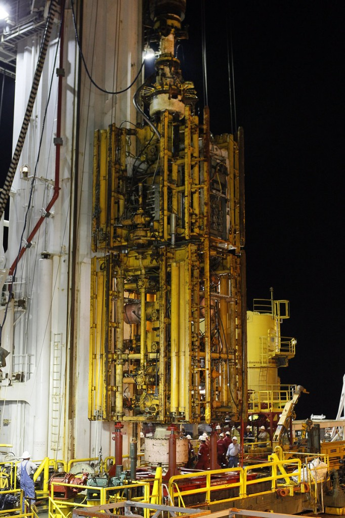 In this 2010 file photo, the Deepwater Horizon blowout preventer stack is lifted onto the deck of the Helix Q4000 in the Gulf of Mexico off Louisiana. A report released Wednesday identified the primary cause of the blowout preventer's failure as the blind shear rams failing to close completely and seal the well because the drill pipe had buckled, bowed and become stuck.