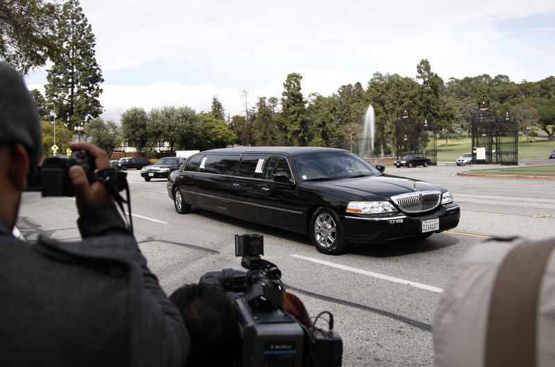 Five limousines carried Elizabeth Taylor's family to her services Thursday at Forest Lawn cemetery in Glendale, Calif., the final resting place for many celebrities, including Michael Jackson.