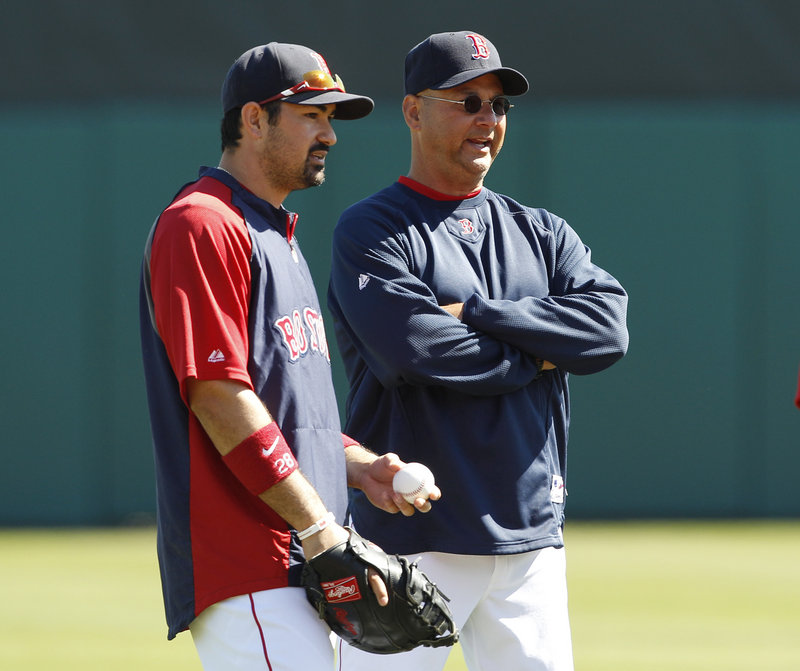 Red Sox Manager Terry Francona, right, will be working with a much-improved lineup this season, including the addition of first baseman Adrian Gonzalez, left.