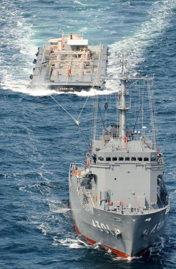A Japanese multipurpose support ship, the Hiuchi, pulls a U.S. vessel loaded with fresh water to be used to help cool the crippled Fukushima Dai-ichi nuclear power plant.