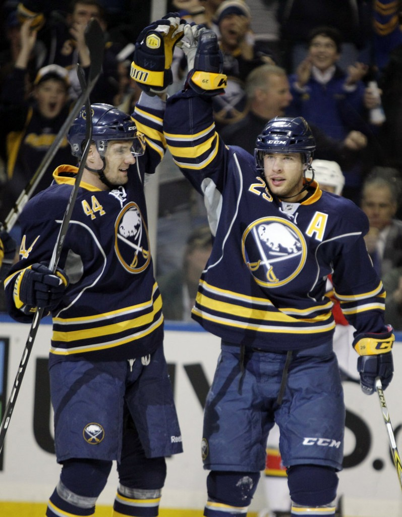 Buffalo's Jason Pominville, right, celebrates his goal with Andrej Sekera during the Sabres' 4-2 win Friday.