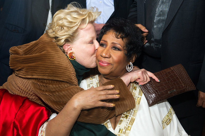 Singer Bette Midler greets Aretha Franklin at Franklin's 69th birthday party in New York late Friday night.