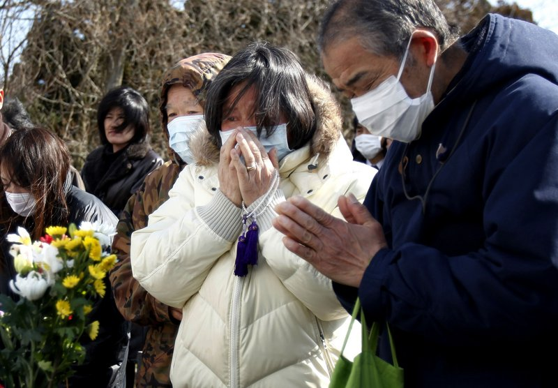 The Associated Press A Japanese mourner cries for a loved one during a mass funeral in Yamamoto, Japan, on Saturday for victims of the March 11 earthquake and tsunami.