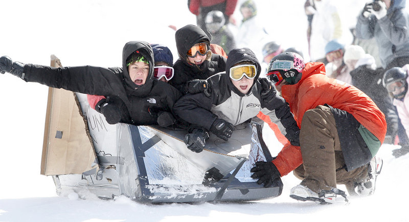 Cardboard box racers, from left, Jack Elder, Julia Primeau, Chapin Dorsett and Rhys Eddy, all 14-year-olds from Yarmouth, get a push as they take off in their Millenium Falcon at Saddleback Mountain in Rangeley on Saturday.
