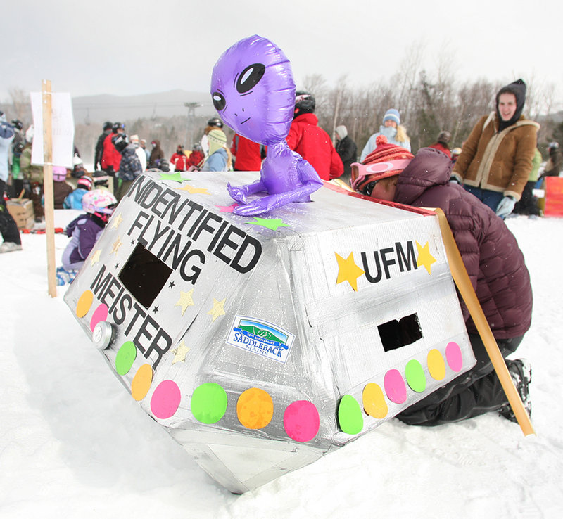 A cardboard craft gets finishing touches before the race. Competitors were judged for the creativity of their sleds, and for whether they made it to the bottom