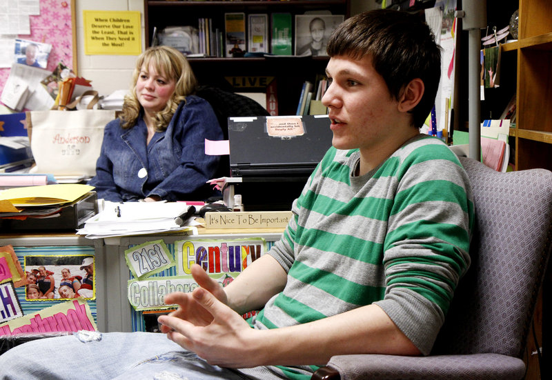 Robbie Blair, a Windham High freshman, explains how the Restorative Learning Program helped him get back to school after a drug-related expulsion. In the background is Sarah Anderson, a social worker and program director.