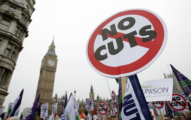 With Big Ben as a backdrop, demonstrators against the government s spending cuts march in London on Saturday.
